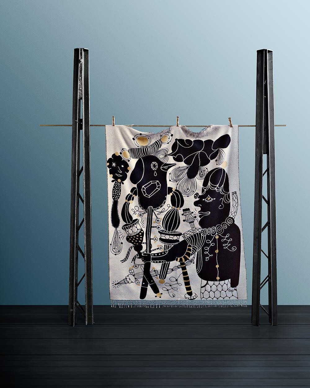 Humoristisk plaid designet af spanske Jaime Hayon for Fritz Hansen.